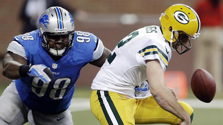 Detroit Lions defensive tackle Nick Fairley (98) causes Green Bay Packers quarterback Aaron Rodgers (12) to fumble in the third quarter of their NFL football game in Detroit, Sunday, Nov. 18, 2012. Detroit recovered the ball. (AP Photo/Paul Sancya