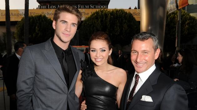 Liam Hemsworth, Miley Cyrus and producer Adam Shankman arrive at the premiere of Touchstone Picture's 'The Last Song' held at ArcLight Hollywood on March 25, 2010 -- Getty Images