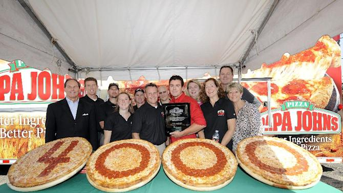 John Schnatter, red shirt, Founder, Chairman and CEO of Papa John's International, Inc., with employees from Pepsico during the grand opening celebration of Papa John's 4000th restaurant on Friday Sept. 14, 2012, in New Hyde Park, N.Y. (Photo by Kathy Kmonicek/Invision for Papa John's/AP Images)
