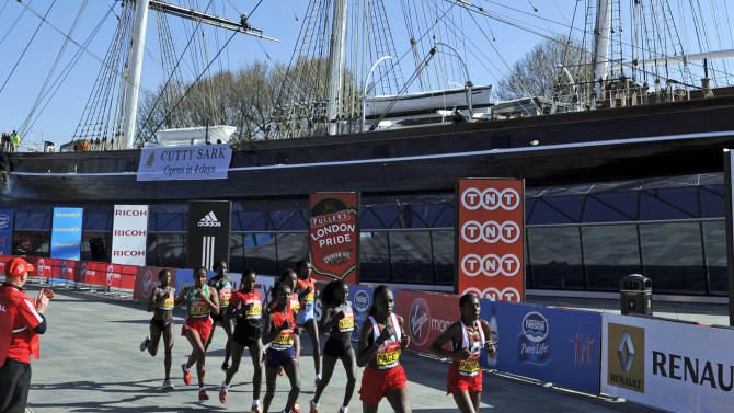 The leading women in the London marathon run past the Cutty Sark, a clipper ship built in 1869, during the London Marathon, London, Sunday April 22, 2012. Kenya's marathon superiority was flaunted Sunday ahead of the Olympics, with Wilson Kipsang and Mary Keitany coasting to victory in London to virtually assure themselves of selection for the games. (AP Photo/Tom Hevezi)