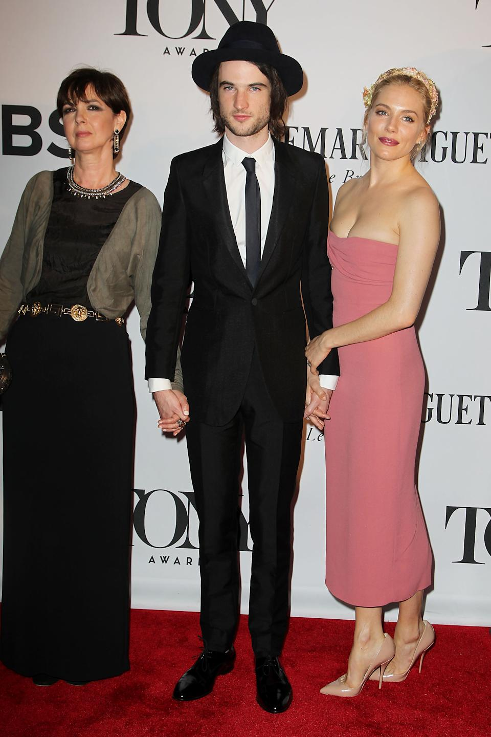 This image released by Starpix shows Tom Sturridge, center, his mother  Phoebe Nicholls, left, and Sienna Miller at the 67th Annual Tony Awards in New York on Sunday, June 9, 2013. (AP Photo/Starpix, Amanda Schwab)