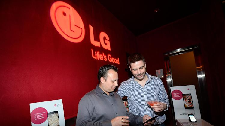 IMAGE DISTRIBUTED FOR LG - CTIA guests demo Nexus 4 and Lucid2 by LG at the Recharge, Refresh & Remix with LG Event at PURE NightClub, on Wednesday, May 22, 2013 in Las Vegas, Nevada. (Photo by Jeff Bottari/Invision for LG/AP Images)