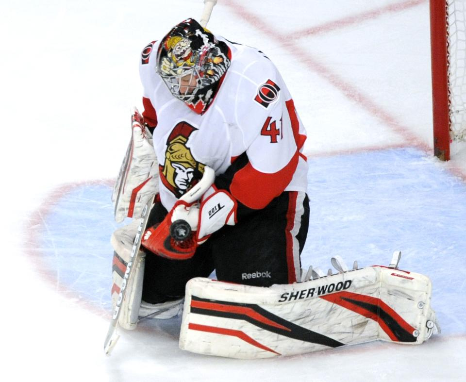 Ottawa Senators goaltender Craig Anderson makes a save against the New York Rangers during the second period of Game 5 of an NHL Stanley Cup first-round hockey playoff series, Saturday, April 21, 2012, at New York's Madison Square Garden. (AP Photo/Bill Kostroun)