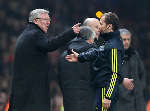 Manchester United's manager Sir Alex Ferguson remonstrates with the fourth official after his player Nani was shown a red card during the Champions League round of 16 soccer match against Real Madrid