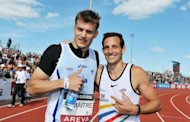 French Christophe Lemaitre (L) poses with pole vaulter Renaud Lavilenie, after he won the 200m final during France&#39;s Athletics championships at &quot;Lac de Maine&quot; Stadium in Angers, western France. Lemaitre, seen as Europe&#39;s biggest hope to break Jamaican and US sprinting hegemony, wrapped up a French sprint triple here on Sunday