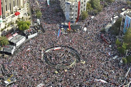 A photo taken from a helicopter shows supporters of Syrian President Bashar al-Assad's gathering during a rally at al-Sabaa Bahrat square in Damascus