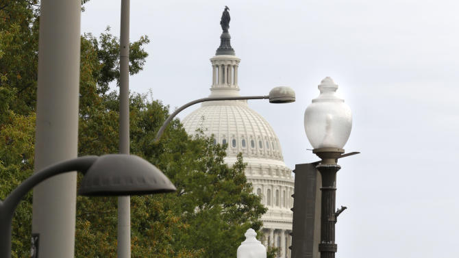 """This photo taken Oct. 1, 2012 shows lopsided street lamps and concrete planters lining Pennsylvania Avenue NW toward the Capitol. Washington's Pennsylvania Avenue. Washington's Pennsylvania Avenue, sometimes called """"America's Main Street,"""" is being listed among the nation's endangered landscapes because of neglect and deferred maintenance by the National Park Service.  (AP Photo)"""