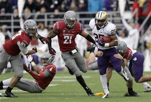 Cougars rally to stun Huskies 31-28 in OT