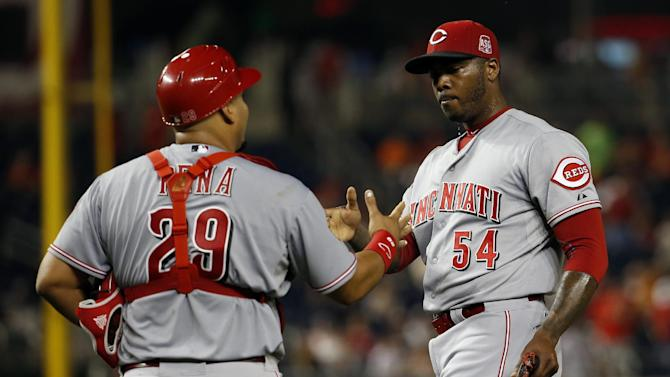 Cincinnati Reds catcher Brayan Pena (29) and relief pitcher Aroldis Chapman (54) celebrate after a baseball game against the Washington Nationals at Nationals Park, Monday, July 6, 2015, in Washington. The Reds won 3-2. (AP Photo/Alex Brandon)