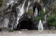 View of the Grotto of Lourdes flooded, in Lourdes, southwestern France, Saturday, Oct. 20, 2012. French rescue services and police are evacuating hundreds of pilgrims from hotels threatened by floodwaters from a rain-swollen river in the Roman Catholic shrine town of Lourdes. (AP Photo/Bob Edme)