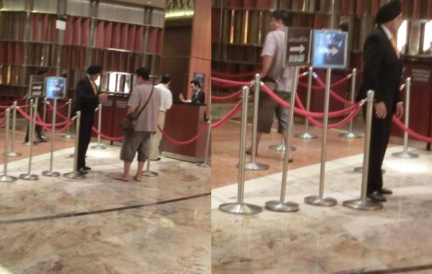 A flip-flop wearing gambler is allowed past checks into the Marina Bay Sands casino (Yahoo! Photos)