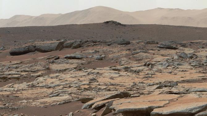 This image from NASA's Curiosity Mars rover released December 9, 2013 shows a series of sedimentary deposits in the Glenelg area of Gale Crater