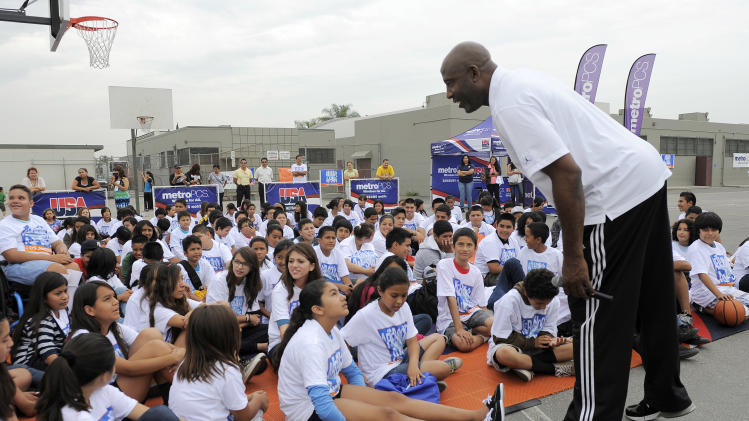 COMMERCIAL IMAGE - USA Basketball legend James Worthy speaks to students at Bell Gardens Intermediate School at the MetroPCS / After-School All-Stars Event on Friday, July 13, 2012 in Bell Gardens, Calif.  (Photo by Chris Pizzello/Invision for MetroPCS/AP Images)