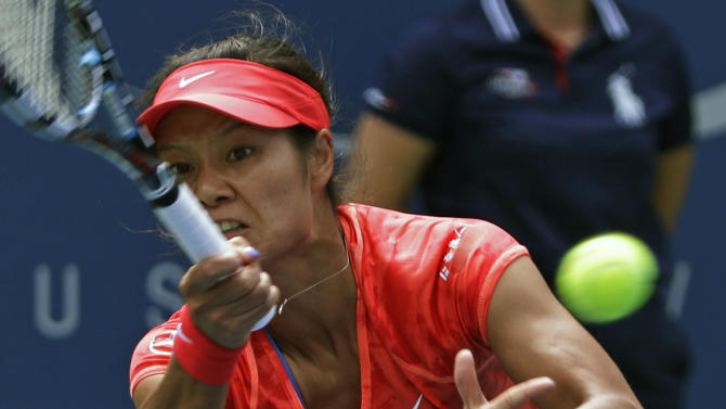 Li Na, of China, returns a shot against Sofia Arvidsson, of Sweden, during the second round of the 2013 U.S. Open tennis tournament, Wednesday, Aug. 28, 2013, in New York. (AP Photo/Kathy Willens)