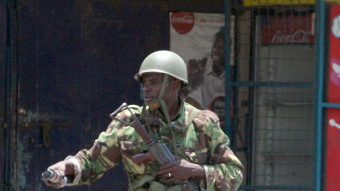 A Kenyan para military officer patrols outside the Masjid Musa Mosque in Majengo, Mombasa, Kenya, Wednesday, Aug. 29, 2012. Police kept a tight security after  riots following the killing of a radical Islamic preacher Aboud Rogo Mohammed, continued Tuesday in Kenya's second-largest city of Mombasa.  A prison official says two guards who were wounded in a grenade attack during riots in Kenya's second largest city of Mombasa have died. James Kodiany, the Coast regional prisons boss, confirmed that two of his officers died Wednesday. Another prison officer died on Tuesday after a grenade was thrown into a truck carrying security officers on their way to quell rioters that had set fire to a church. The death of the prison officers raised the death toll from two days of rioting following the killing of Muslim cleric Aboud Rogo Mohammed to four. A civilian was killed on Monday. (AP Photo/ Sayyid Azim)