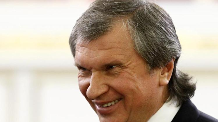 Rosneft President and Chairman of the Management Board Igor Sechin smiles before a signing ceremony after talks with the Chinese delegation at the Kremlin in Moscow