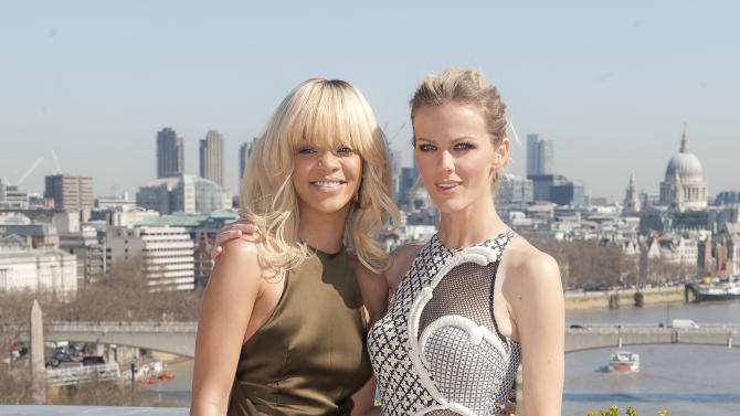 Rihanna and Brooklyn Decker, right, pose for photographers in front of a London skyline atop a central London hotel during a photocall for their film 'Battleship', Wednesday, March 28, 2012. (AP Photo/Joel Ryan)