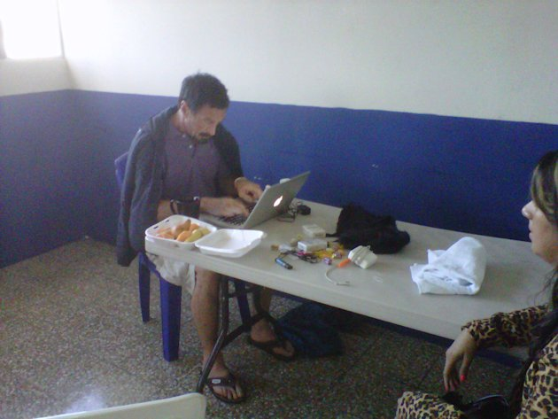 In this image made using a cell phone, software company founder John McAfee updates his blog at an immigration detention center in Guatemala City, Thursday, Dec. 6, 2012. The anti-virus guru was arres