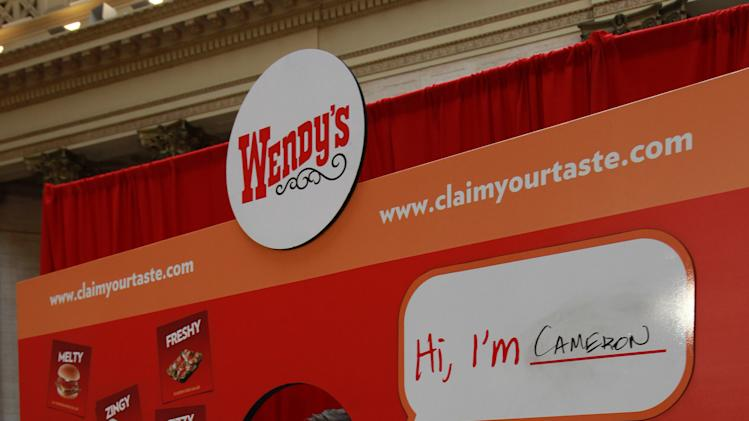Consumers pose for photos at Wendy's ClaimYourTaste.com event at Union Station, on Tuesday, Jan. 15, 2013 in Chicago. (Photo by Barry Brecheisen/Invision for Wendy's/AP Images)