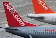 A Jet2.com flight at Gatwick airport. Britain&#39;s Manchester Airport launched an urgent investigation Wednesday after an 11-year-old boy managed to slip through security and fly to Rome without a passport or ticket. Passengers noticed halfway through the flight that the boy was alone and alerted the cabin crew