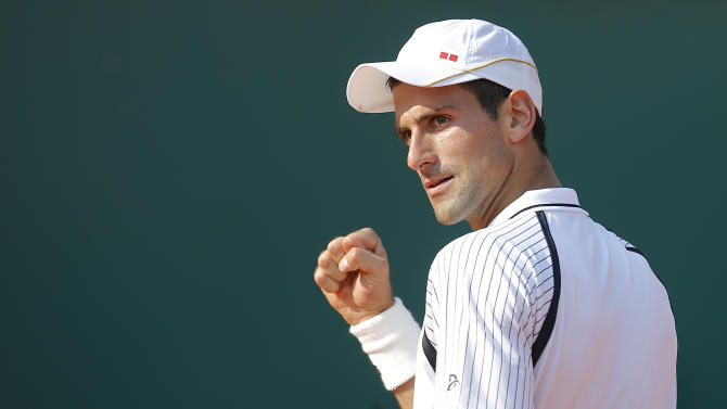 Novak Djokovic of Serbia reacts during his match of the Monte Carlo Tennis Masters tournament in Monaco against Juan Monaco of Argentina, Thursday, April 18, 2013. (AP Photo/Lionel Cironneau)