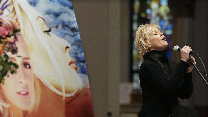 """Lorrie Morgan sings """"Ave Maria"""" during a memorial service for fellow country singer Mindy McCready on Wednesday, March 6, 2013, in Nashville, Tenn. McCready committed suicide Feb. 17 in Heber Springs, Ark. Old friends Bryan White, Lorrie Morgan and Bekka Bramlett sang for McCready and family members spoke about her difficulties and triumphs during the hour-long remembrance Wednesday at the Cathedral of the Incarnation. (AP Photo/Mark Humphrey)"""