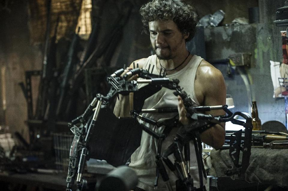 "This film publicity image released by TriStar, Columbia Pictures-Sony shows Wagner Moura in a scene from ""Elysium."" (AP Photo/TriStar, Columbia Pictures - Sony, Kimberley French)"