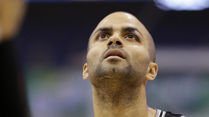 San Antonio Spurs' Tony Parker (9), of France, prepares to shoot a free throw in the second half of an NBA basketball game against the Dallas Mavericks, Friday, Jan. 25, 2013, in Dallas. Parker suffered an injury to his left eye early in the game but after receiving treatment he continued playing. The Spurs won 113-107. (AP Photo/Tony Gutierrez)