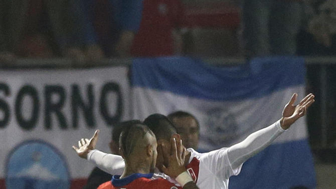 Chile's Arturo Vidal, left, and Peru's Carlos Zambrano confront eachother during a Copa America semifinal soccer match at the National Stadium in Santiago, Chile, Monday, June 29, 2015. (AP Photo/Ricardo Mazalan)