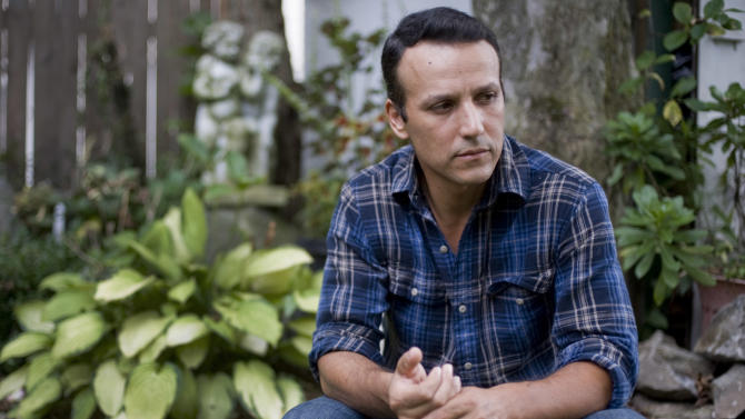 In this Tuesday, Aug. 14, 2012 photo, Rony Molina poses for a photograph at his home in Stamford, Conn. Molina's wife Sandra was deported to Guatemala in 2010, leaving Molina alone to care for their three children, all American citizens. (AP Photo/Jessica Hill)