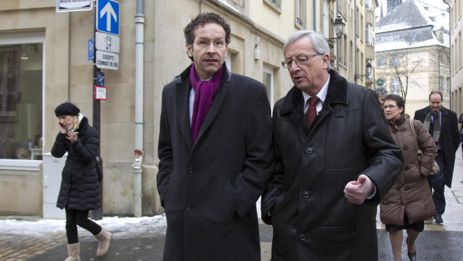 Luxembourg's Prime Minister and head of the eurogroup Jean-Claude Juncker, right, walks with Dutch Finance Minister Jeroen Dijsselbloem in Luxembourg on Friday, Jan. 18, 2013. The outgoing leader of the group of finance ministers from the 17 European Union countries that use the euro is meeting with Jeroen Dijsselbloem on Friday, another indication the Dutch finance minister will take the post next week. (AP Photo/Virginia Mayo)