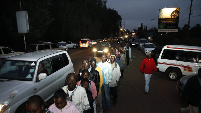 Kenyans lineup as early as 4 a.m. to cast their ballots in a general election in Nairobi, Kenya, Monday, March 4, 2013. Five years after more than 1,000 people were killed in election-related violence, Kenyans went to the polls on Monday to begin casting votes in a nationwide election seen as the country's most important - and complicated - in its 50-year history.  (AP Photo/Sayyid Azim)