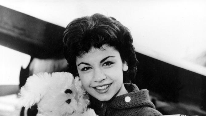 FILE - In this March 24, 1959 file photo, Walt Disney studio's new star, 16-year-old Annette Funicello, poses with her Shaggy Dog doll, at Idlewild Airport in New York. Walt Disney Co. says, Monday, April 8, 2013, that Funicello, also known for her beach movies with Frankie Avalon, has died at age 70. (AP Photo/File)