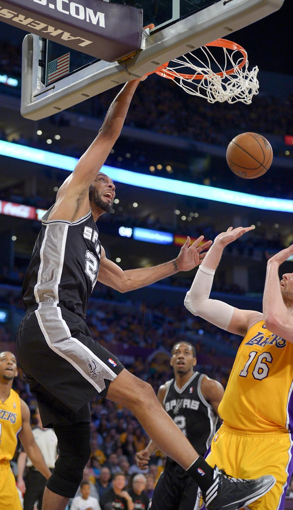 San Antonio Spurs forward Tim Duncan, left, dunks over Los Angeles Lakers forward Pau Gasol (16), of Spain, during the first half in Game 3 of a first-round NBA basketball playoff series on Friday, April 26, 2013, in Los Angeles. (AP Photo/Mark J. Terrill)