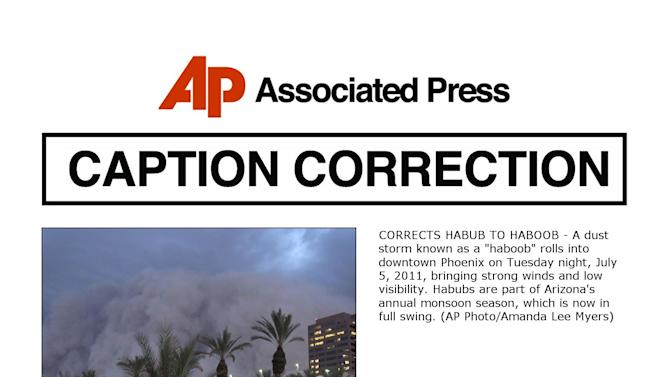 "CORRECTS HABUB TO HABOOB - A dust storm known as a ""haboob"" rolls into downtown Phoenix on Tuesday night, July 5, 2011, bringing strong winds and low visibility. Habubs are part of Arizona's annual monsoon season, which is now in full swing. (AP Photo/Amanda Lee Myers)"