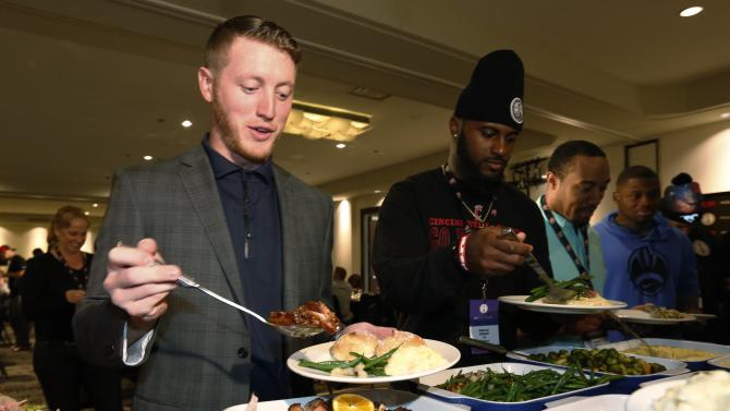Calgary Stampeders Mitchell gets his turkey dinner during their team's lunch at the CFL's 102nd Grey Cup week in Vancouver
