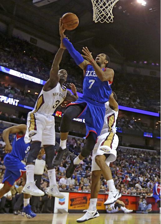 Philadelphia 76ers point guard Darius Morris (7) goes to the basket against New Orleans Pelicans shooting guard Anthony Morrow (3) in the second half of an NBA basketball game in New Orleans, Saturday