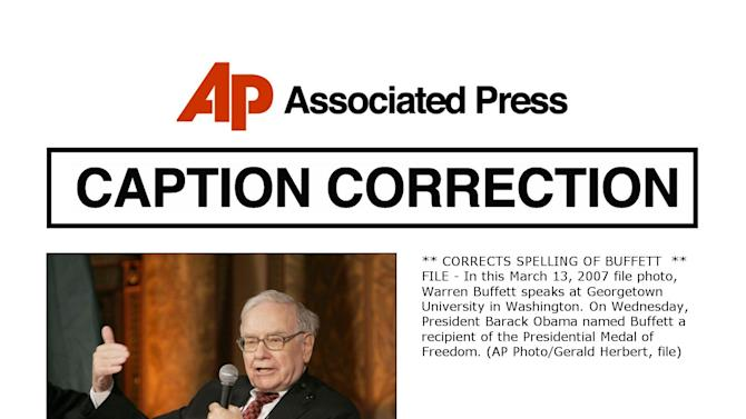 ** CORRECTS SPELLING OF BUFFETT  ** FILE - In this March 13, 2007 file photo, Warren Buffett speaks at Georgetown University in Washington. On Wednesday, President Barack Obama named Buffett a recipient of the Presidential Medal of Freedom. (AP Photo/Gerald Herbert, file)