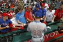 Texas Rangers' Josh Hamilton signs autographs for fans prior to the Rangers baseball game against the Cleveland Indians Monday, May 25, 2015, in Cleveland. (AP Photo/Aaron Josefczyk)
