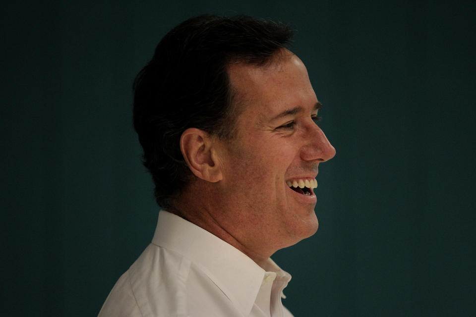 Republican presidential candidate, former Pennsylvania Sen. Rick Santorum smiles during his campaign stop in Platteville, Wis., Saturday, March 31, 2012. (AP Photo/Jae C. Hong)
