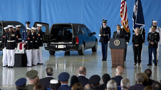 President Barack Obama, accompanied by Secretary of State Hillary Rodham Clinton, speaks during the Transfer of Remains Ceremony, Friday, Sept. 14, 2012, at Andrews Air Force Base, Md., marking the return to the United States of the remains of the four Americans killed this week in Benghazi, Libya. Obama said in a Rose Garden statement after the attack that those responsible would be brought to justice. That may not be swift. Building a clearer picture of what happened will take more time, and possibly more people, U.S. officials said Friday. (AP Photo/Carolyn Kaster)