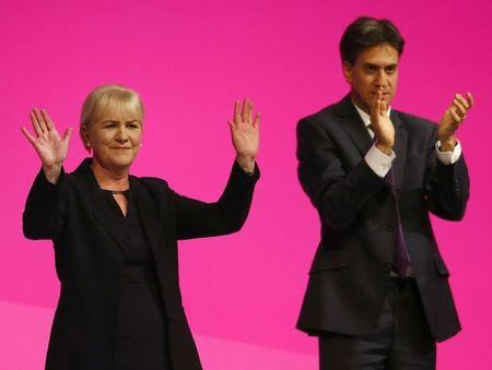 Britain's opposition Labour Party leader Ed Miliband applauds Scottish Labour Party leader Johann Lamont during Labour's annual conference in Manchester