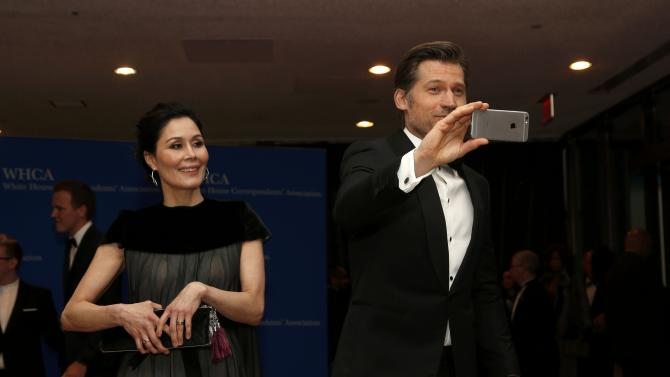 Actor Coster-Waldau and his wife Nukaka arrive for the annual White House Correspondents; Association dinner in Washington