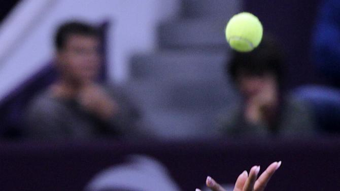 Serena Williams of the U.S. serves to Daria Gavrilova of Russia during the Second day of the WTA Qatar Ladies Open in Doha, Qatar, Tuesday, Feb. 12, 2013. (AP Photo/Osama Faisal)