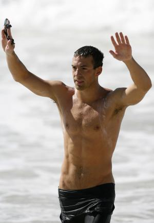 FILE - In this July 14, 2007, file photo, Fran Crippen of the U.S. waves after finishing first and winning the gold medal in the Pan American Games 10-km men's swimming marathon at Copacabana beach in Rio de Janeiro. Two years removed from the tragic open water race that claimed the American swimmer's life, the sport has yet to take all the necessary steps to ensure we don't have another Fran Crippen. (AP Photo/Dario Lopez-Mills, File)