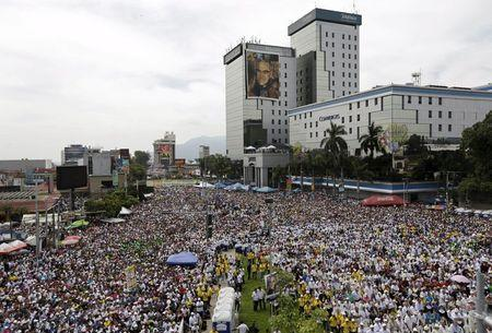 Catholic faithful attend the beatification ceremony of the late Archbishop of San Salvador Oscar Arnulfo Romero at El Salvador del Mundo square in San Salvador