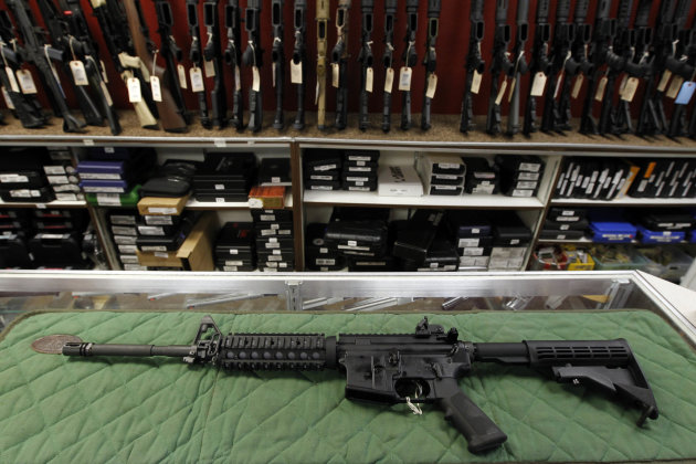 <p>               FILE - In this Thursday, July 26, 2012 file photo, an AR-15 style rifle is displayed at the Firing-Line indoor range and gun shop in Aurora, Colo. Demand for firearms, ammunition and bulletproof gear has jumped since the Dec. 14 school shooting in Newtown, Conn., that killed 20 children and six adults. Politicians, including President Barack Obama, have called for tighter gun control since then. That has sent Americans into a panic, buying as many guns and as much ammunition as they can get their hands on before any type of ban is set. (AP Photo/Alex Brandon, File)