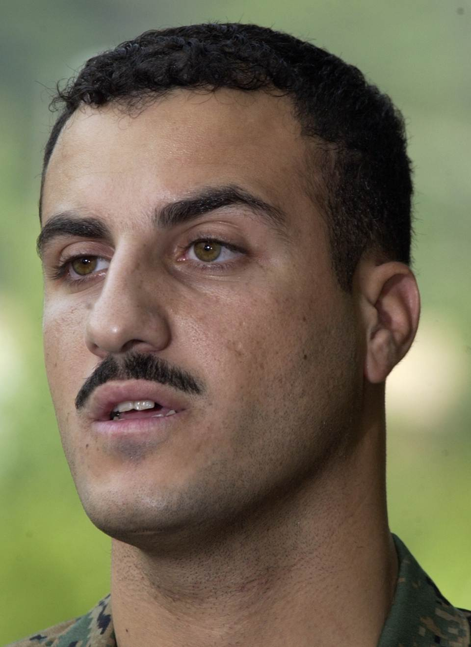 In this July 19, 2004 file photo, Marine Cpl. Wassef Ali Hassoun makes a statement to the press outside Quantico Marine Base in Quantico, Va.  A...