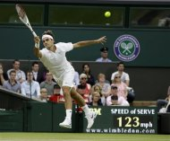 Roger Federer of Switzerland returns a shot to Julien Benneteau of France during a third round men's singles match at the All England Lawn Tennis Championships at Wimbledon, England, Friday, June  29, 2012. (AP Photo/Alastair Grant)