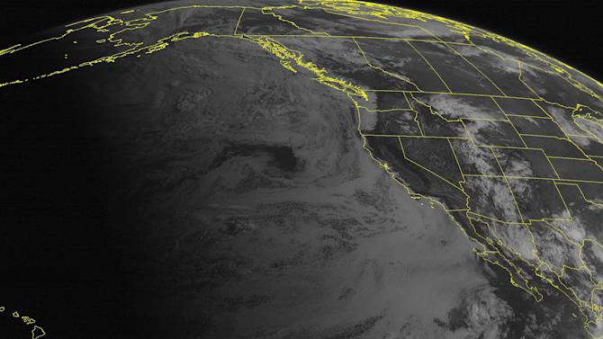 This NOAA satellite image taken Friday, July 27, 2012 at 11:00 AM EDT shows clouds cover most of the Rockies as monsoonal moisture advances northward from the Four Corners.  In California, warm and sunny conditions continue as high pressure dominates.  However, in the north, a trough of low pressure moves through the Pacific Northwest, pushing cooler air and cloudy skies in from the coast.  (AP Photo/Weather Underground)